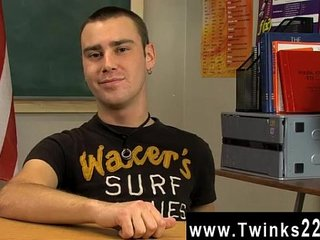Naked men Young black-haired lad Justin Giles sits at a desk in a