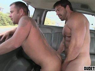 muscular bear fucks a gay hunk in a van