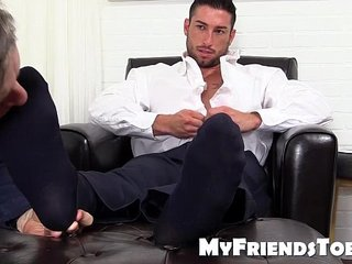 Cute business man with tattoos gets foot worshiped