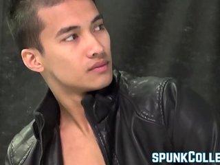 Feminine Asian jock Ken Ott toying his rock hard dick